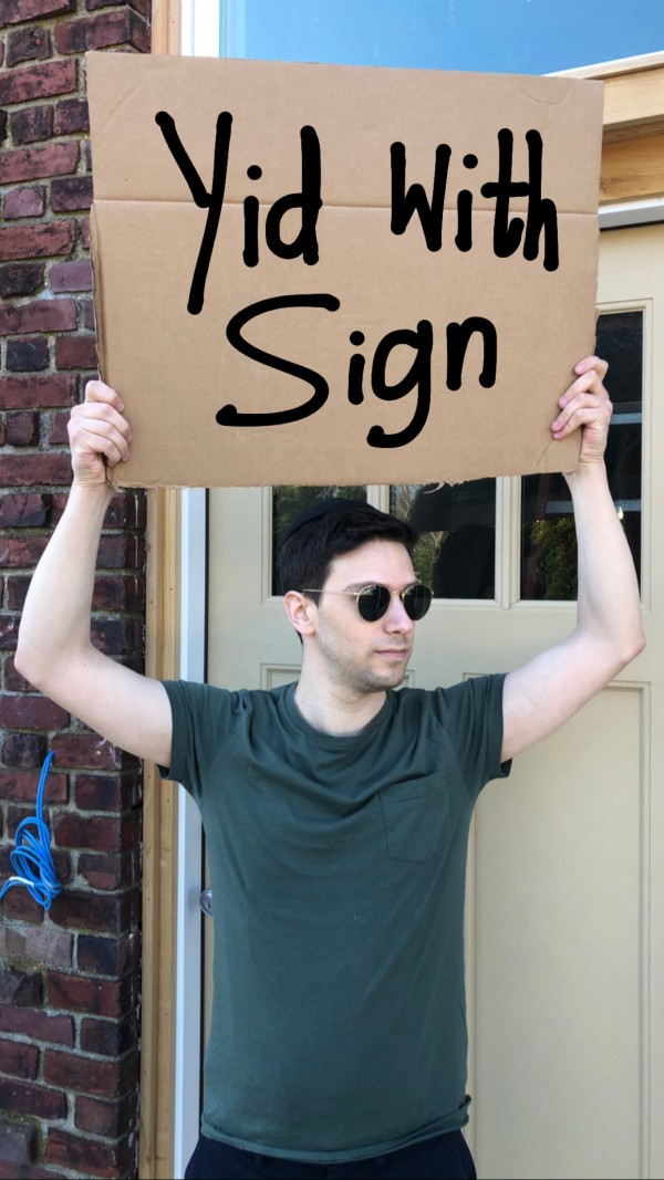 Yid With Sign